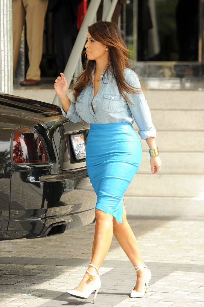 Kim Kardashian wearing denim shirt tucked into a blue skirt