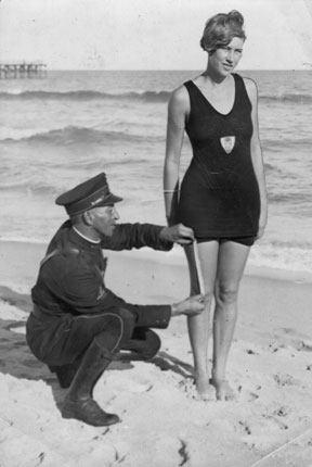 bikini history cop measuring length of bikini