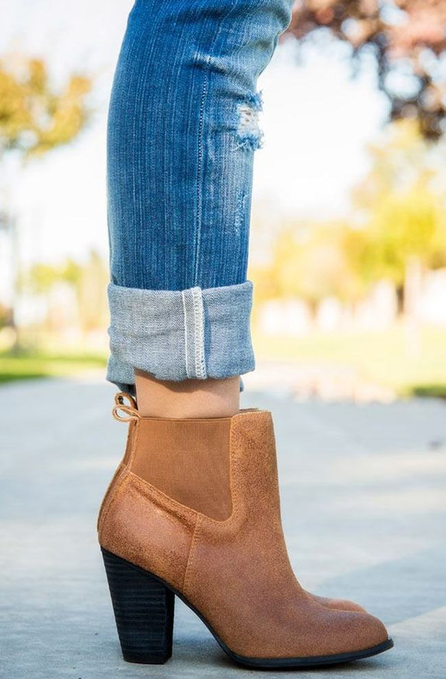 How to Wear Ankle Boots with Skinny Jeans Generally, boots with a taller shaft look best with skinny jeans tucked in, and boots with a lower shaft look better with jeans .