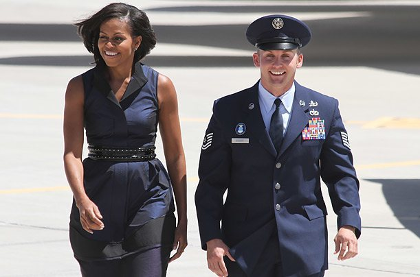 michelle obama Dressed in a navy frock