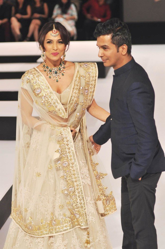 Malaika Arora Khan walking the ramp with designer Vikram Phadnis