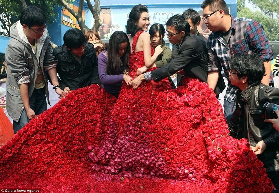 red wedding gown made of roses