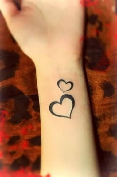 Love Symbol Wrist Tattoo