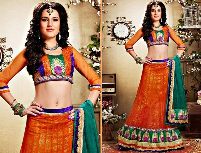 bewitching orange net lehenga choli