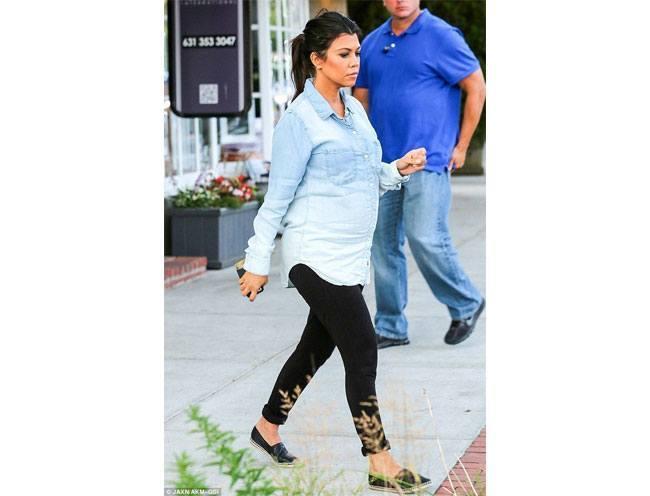 Kourtney Kardashian in a denim tunic shirt