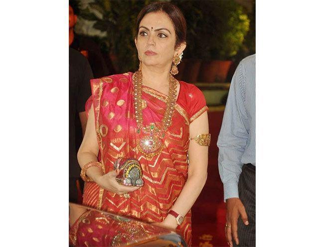 Nita Ambani in Esha Deols wedding in a red silk saree