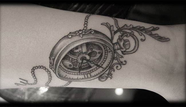 Antique timepiece tattoo