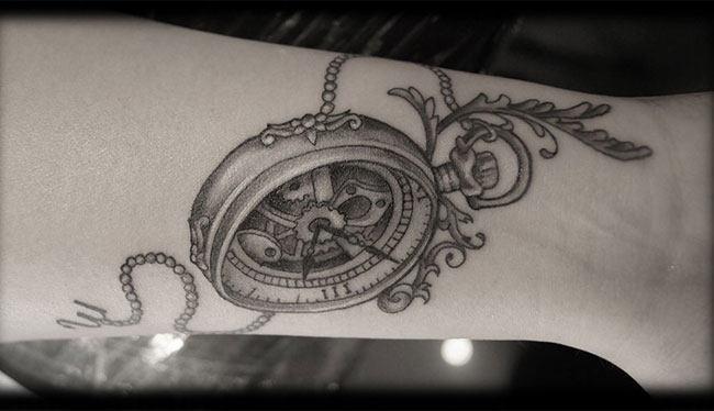 Antique timepiece tattoo