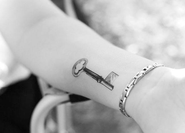 Key wrist tattoo