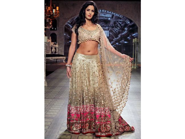 Make a head turning look at your reception with golden lehenga