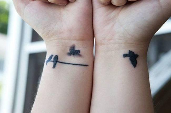 Flying bird wrist tattoo