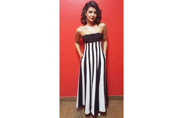 Priyanka Chopra was cute in a striped Dior gown and Zara pumps at Anupam Kher Show