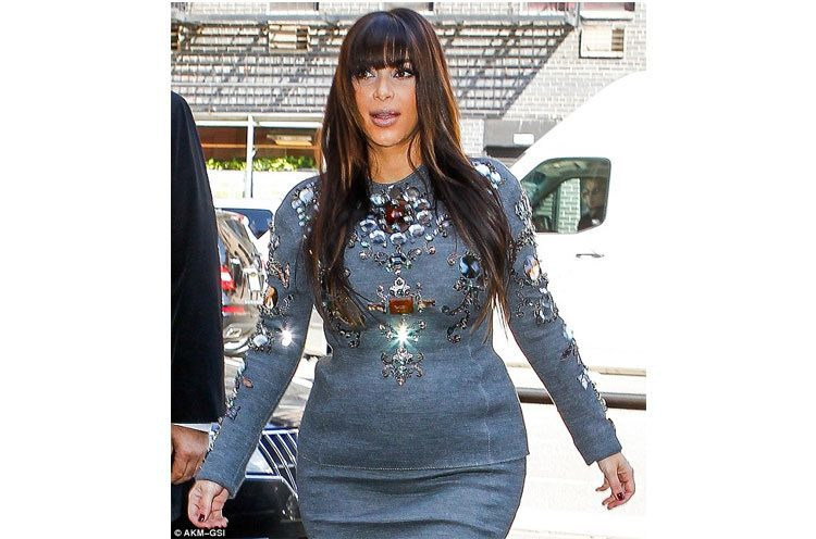Kim Kardashian showing her maternity curves in bejewelled dress
