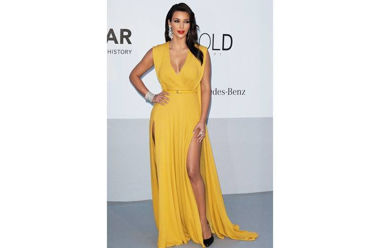 Kim in yellow slit gown