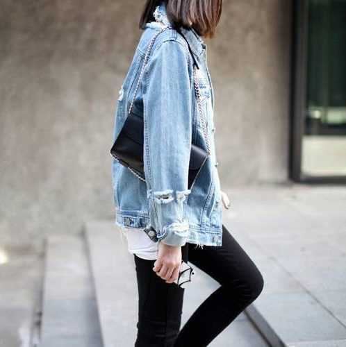 wearing distressed jeans
