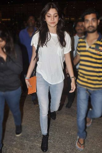 Anushka Sharma in blue jeans and white tee