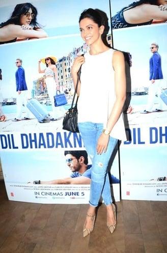 Deepika Padukone looks in white T-shirt and blue denim