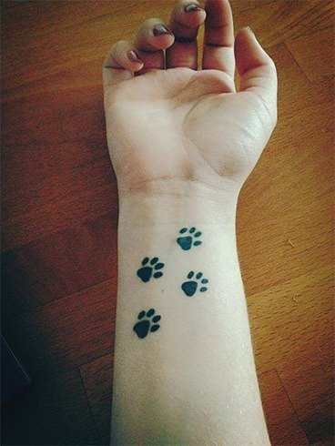 Paws tattoo on wrist