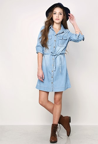 Rolling up the sleeves of long denim shirt-styled dresses