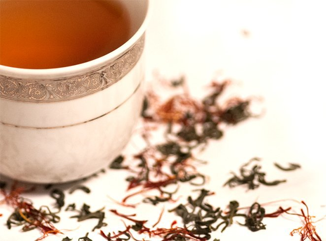 Green tea leaves and saffron tea