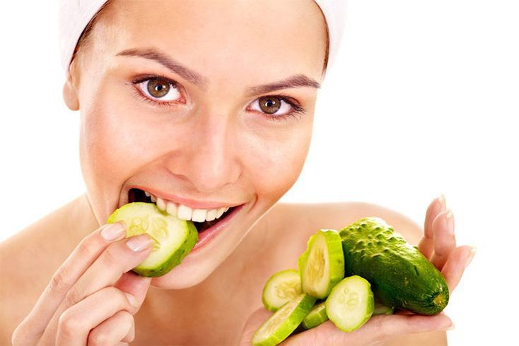 Women eating cucumber