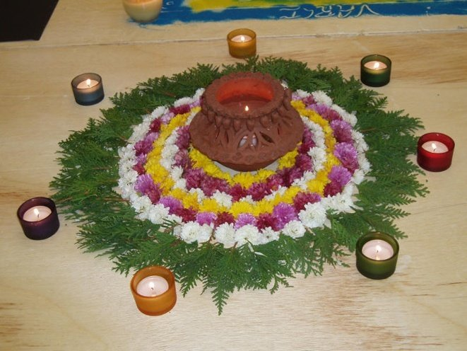 Rangoli from whole flowers and leaves