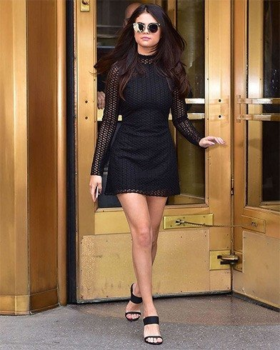 Selena in black long sleeved dress