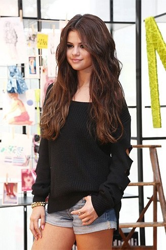 Selena in black oversized cardigan