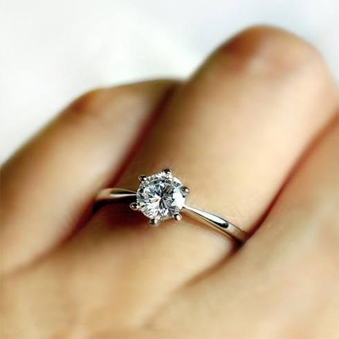 the glamour of this sterling silver engagement ring is enough to