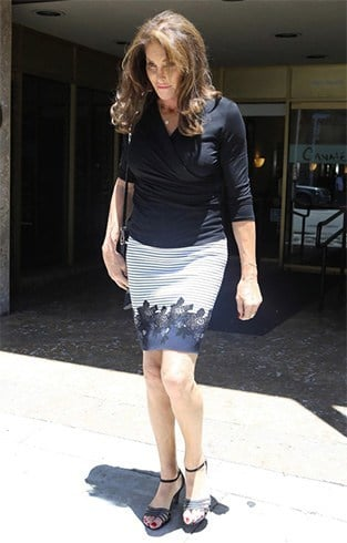 Caitlyn in black top and pencil skirt