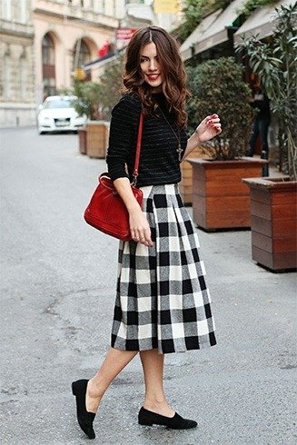 Striped shirt with tartan skirt
