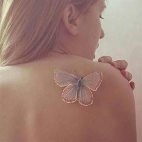 White Ink Tatoo On Shoulder