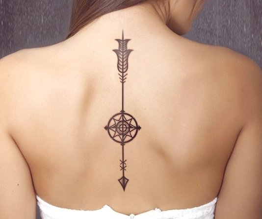 Arrow On Spine Tattoo
