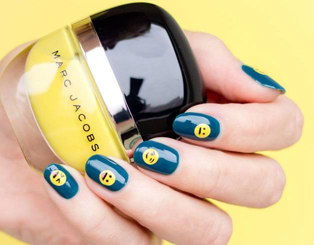 Blue background Emoji Nail Art.