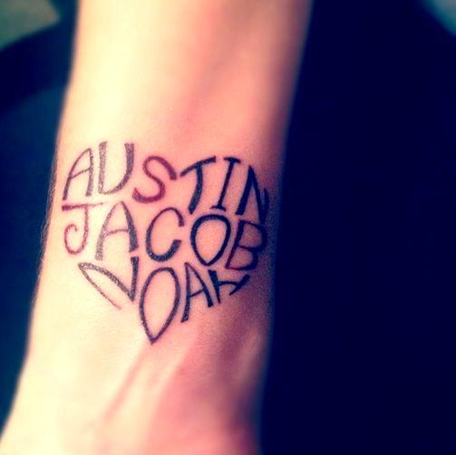 Name on wrist tattoo