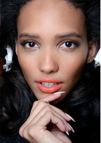 Wearing orange lipstick
