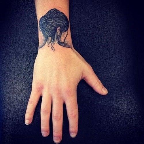 girl tattoo on wrist