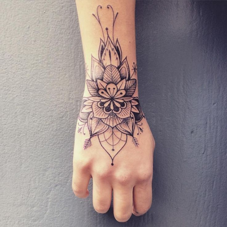 upper wrist tattoo