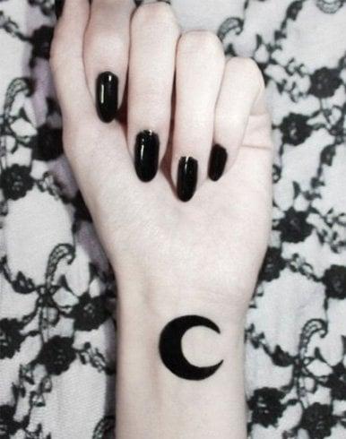 Single moon tattoo