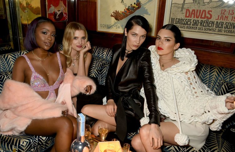 Bela Hadid, Kendall Jenner, Lily Donaldson and Justine Skye seem to have a ball at the Burberry and LOVE party.