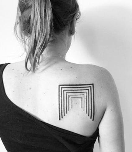 Rose tattoo on shoulder