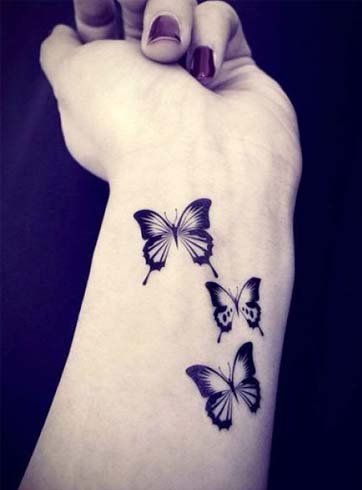 Butterfly tattoos on hands for ladies