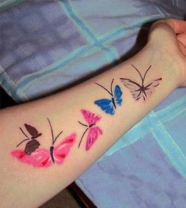 Butterfly tattoos on hands for women