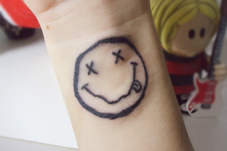 show off your fun side with these smiley tattoos