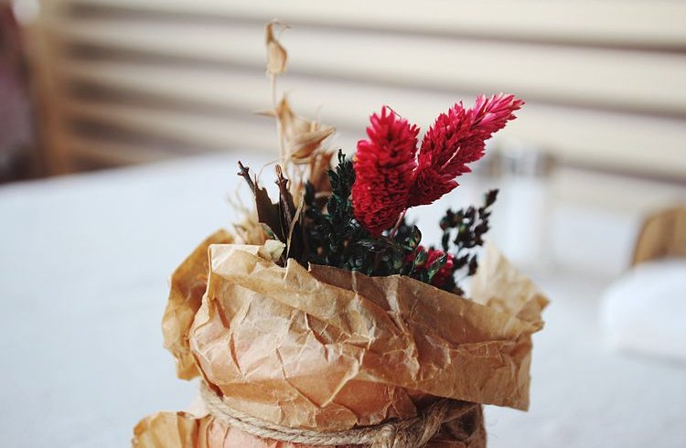A Vase With A Paper Bag
