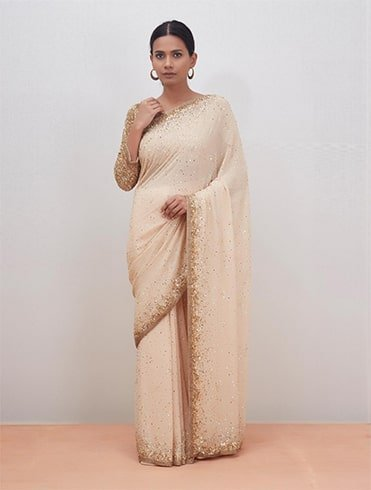 beige sequin saree with stitched blouse